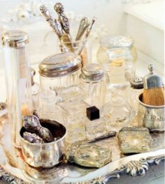 The Dressing Table - this is a creative way to organize necessities by displaying in vintage jars on a silver tray - via Vignette Design