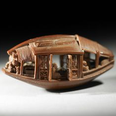 This olive pit was carved into a beautiful boat by Ch'en Tsu-chang in 1737.