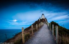 """Dusk at Nugget Point"" in The Catlins, New Zealand.  This lighthouse is a must visit on any road trip holiday along this rugged Southland coastline."
