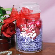 Our Hearts Belong To Engraved Glass Treat Jar. Sweeten up Valentine's Day in a deliciously fun way with our Personalized Be Mine Candy Jar, Sure to make their heart melt, this Candy Jar makes a great gift for your sweetheart on any romantic gift giving occasion. Let them know how much they mean to you with a Personalized Candy Jar that is filled with delicious treats! We fill the jar with 1/2 pound or approx. 30 delicious, mouth watering Chocolate Hearts individually