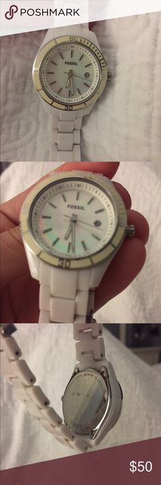 White Fossil watch Beautiful white Fossil watch with unique colored face. Great condition, hasn't been worn that much. Needs new battery. Fits small to medium size wrist Fossil Accessories Watches