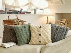 Home Made Modern: Copycat Craft: Cozy Sweater Pillows Made From Old Sweaters - These can also make good mittens or dog sweaters.