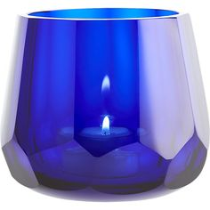 Shop archer tea light candle holder.   Like a sparkling sapphire for the table, this hand-faceted glass tea light holder radiates gem-like beauty from every angle.