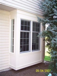 Box Bay Window - This style of window projects from the side of the home. The window creates extra space in front of a kitchen or a desk.