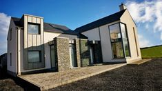 Designed as an evolution of the traditional form and located next to the main Sligo-Donegal road, the super insulated and triple glazed house minimises the noise pollution from the busy road in addition to its energy rating. House Designs Ireland, Vernacular Architecture, Modern Exterior, House 2, Building A House, House Plans, Outdoor Structures, Mansions, House Styles