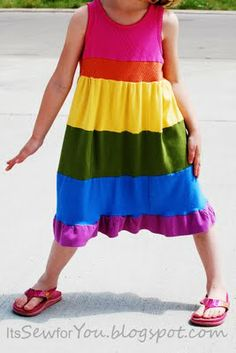 Rainbow Dress Tutorial. A friend's daughter had on a dress from Target that looked like this, only the top was a t-shirt with cross over top, and the stripes were narrower.  The top of each stripe was a raw edge with serged top stitching.  No ruffle at the bottom.