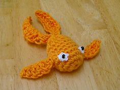 Ravelry: Goldfish Cat Toy pattern by Lion Brand Yarn Crochet Cat Toys, Crochet Fish, Crochet Cat Pattern, Cute Crochet, Crochet Animals, Crochet Crafts, Crochet Dolls, Crochet Projects, Crochet Patterns