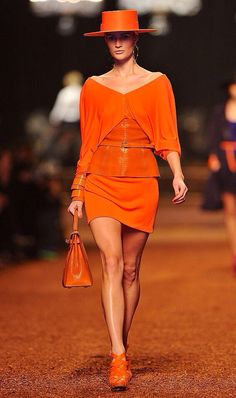 Girl wearing a Orange Hat & Outfit