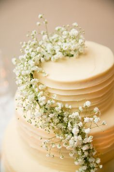 Baby's Breath Garland on Wedding Cake | See the wedding on Style Me Pretty: http://www.StyleMePretty.com/california-weddings/2014/02/17/mankas-boathouse-wedding-with-a-bowtie-bar/ Larissa Cleveland Photography