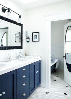 deep blue painted vanity, hex tile floor with mini florets