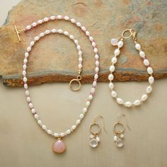 PINK PLEASURES, SET OF 3--Perfect pieces in pink and white. Necklace of white cultured rice pearls and pink sapphires with a faceted chalcedony pendant framed in 18kt vermeil with 14kt gold filled toggle clasp. Bracelet of white cultured pearls, pink sapphires, 14kt gold filled seed beads and rose quartz briolette, with 14kt gold filled ring and lobster clasp. Earrings with rose quartz briolettes, faceted moonstones and rice pearls on 14kt gold filled hoops and French earwires. Handmade…