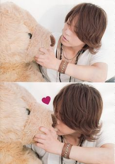 Kazuya Kamenashi. Yeah, so I don't know why I find a grown man kissing a giant teddy bear adorable, but you know. I do. And, you know. I should be where that bear is.