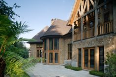 Timber frames and steel window inserts make a perfect match for this beautiful property - see more at http://www.clementwindows.co.uk/ #Home #DreamHome #SteelWindows #SteelFrame #MetalFrame #MetalWindows #ClementWindows #Architecture #House #SteelDoors #MetalDoors