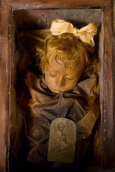 This is one of the best-preserved bodies in the world. Her name is Rosalia Lombardo, she is a Sicilian two-year-old who died of pneumonia in 1920. Her body was embalmed and placed in the Capuchin catacombs of Palermo.