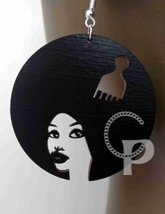 African woman sillhouette natural hair updo Afro locs wooden earrings in black