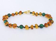 Knotted amber bracelet for babies malachite от AmberJewelryStore