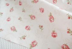 This fabric is a white cotton fabric with pink rose floral, medium weight, two pattern available: small rose and large rose. Please leave message
