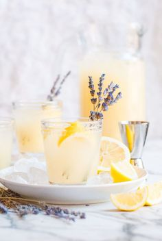 Grab yourself a glass of this refreshing lavender lemonade cocktail! This 5-ingredient lavender lemonade cocktail recipe is a fun twist on the classic lemonade. All you need to do is whip up some lemon peel lemonade, make an easy lavender simple syrup, and splash in some vodka. Cheers! #cocktail #lemonade #recipe | Michele Sidorenkov, RDN Champagneandpaperplanes.com