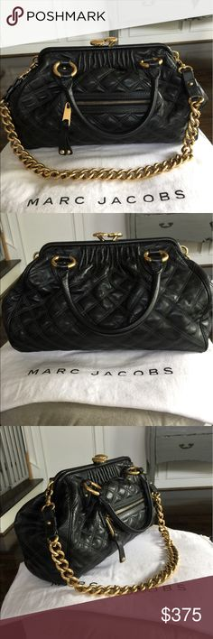 "Marc Jacobs Black Leather Stam Handbag An absolute classic! This handbag was sadly discontinued in 2013, so don't miss this chance. It has some minor scratches on the hardware and corners but is otherwise in great shape. Dual rolled top handles. Detachable chain strap. Kiss lock closure. Quilted. Front zip pocket. Metal feet on bottom. Interior slip pocket and zip wall pocket. 10""H x 15""W x 6""D. Aprox. 5"" handle drop, 13"" strap drop. Made in Italy. Original dustbag and proof of authenticity…"