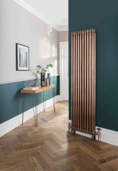 This dark green and light gray hallway with wooden floor is light .-Dieser dunkelgrüne und hellgraue Flur mit Holzboden ist hell und freundlich – Wood Design This dark green and light gray hallway with wooden floors is bright and friendly - Vertical Radiators, Slimline Radiators, Tall Radiators, Hallway Designs, Wooden Flooring, Flooring Ideas, Hallway Flooring, Dado Rail Hallway, Hallway Walls