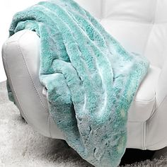 Give the gift of luxury with our faux Chinchilla Throw in Aquamarine, $149.95 @Sam Taylor Homes