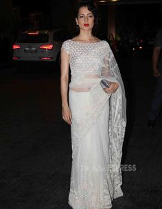 Kangana Ranaut, who is busy shooting for Vishal Bhardwaj's 'Rangoon' with Shahid Kapoor and Saif Ali Khan, was a vision in white net sari with a heavy blouse. She added a pop of colour with her red lipstick. Sari Design, White Saree, Choli Designs, Stylish Sarees, Indian Couture, Indian Sarees, Indian Dresses, Indian Wear, Party Wear