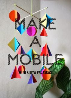 Um móbil  de papel  com formas geométricas coloridas...super-fácil!       FULL TUTORIAL HERE       via Paper Runway                pos...