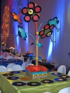 The amazing centerpiece flowers were made from 45 records. by heidi