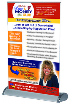 """This little 11""""w x 17"""" h table top retractable banner packs a punch! Katrina Sawa uses one at the back of the room to promote her mastermind and coaching program. Learn more at www.backoftheroomproductions.com"""