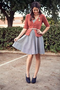gingham. blue. dress. cardigan. belted. brooches. navy.