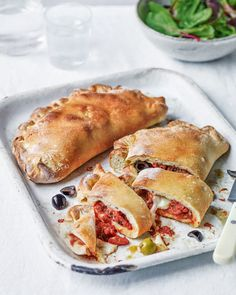 This vegetarian calzone recipe sees ready-made pizza dough stuffed with olives, artichokes and mozzarella to create an oozy filling as it bakes in the oven. Pizza Recipes, Savoury Recipes, Roasted Artichoke, Artichoke Recipes, Vegetarian Italian, Savoury Baking, Delicious Magazine, Unique Recipes, Pizza
