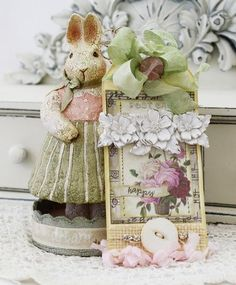 love the shabby bunny holding the tag.  shabby spring...