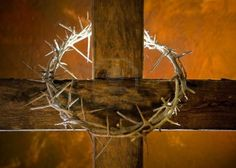 Crown of thorns hung around the Easter cross Stock Photo