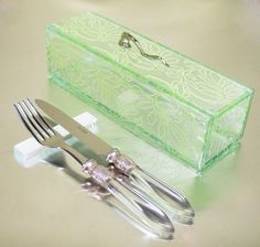 Glass box with lid in mint green color and cutlery rest tabletop accessories. By Glass Sudio