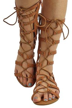 Rustic studs highlight the slender straps of an attention-grabbing gladiator sandal detailed with crisscrossing laces up the front shaft. Shoe measures 12 inches from bottom of heel to top edge. Tan Sandals Heels, Lace Up Sandals, Flats, Shoe Wardrobe, Shoe Pattern, Summer Shoes, Summer Outfits, Types Of Shoes, Cute Shoes