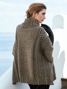 A trendy oversized poncho defined by its pairs of ornamental cables on each wide shoulder part. It is knitted flat in two parts with shoulder and neck shaping. Knit with yds DK-weight yarn using U. Design by Li. Knitted Poncho, Knit Cardigan, Dress Gloves, Arm Knitting, Stockinette, Knitwear, Knitting Patterns, Knit Crochet, Sweaters For Women