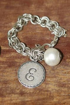 "John Wind initial bracelets! Available in gold & silver. Pearl is actually a cotton ball! Just bought one this weekend (with an ""N"").  Love it!"