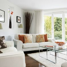 white with a splash of orange accents living room