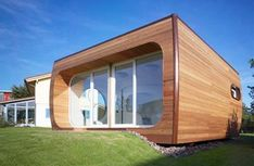 Designer Luigi Colani has created a space-saving house with a six square meter cylinder inside that contains a bedroom, kitchen and bathroom. You can see the cylinder opening through the glass Colani Design, Bio Design, Beautiful Small Homes, Micro House, Unusual Homes, Small House Design, Cubes, Modern Architecture, Future House