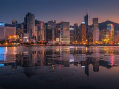 HKG promenade reflection by Coolbiere. A. on 500px