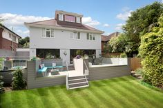 Multi-levelled decked area created with VertiGrain 2 Grey deckboards Grey Gardens, Composite Decking, Modern Buildings, Dream Garden, Real Wood, Composition, Patio, Mansions, House Styles