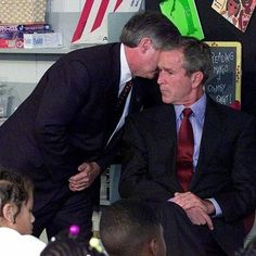 President Bush being informed of the attack on the Twin Towers