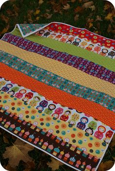 Little Kukla baby quilt by Rachel Griffith ***cute idea for a baby/kids quilt, coordinating fabric strips, could be of varied widths, this would work for quilt as you go***