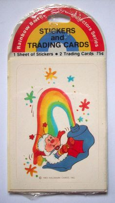 """Vintage Rainbow Brite Stickers and Trading Cards package from Hallmark, 1983. Package is unopen. Has 1 sheet of stickers and2 trading cards. Package measures about 5"""" by 2 5/8"""". Two pin holes through top area - no damage to sticker or cards. 