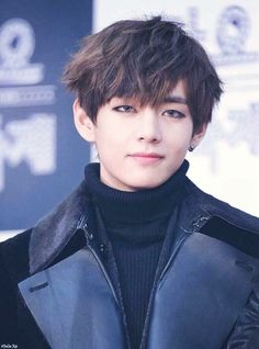 BTS V Rocking some colored contacts...