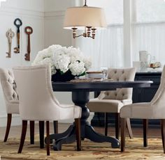 Amazing traditional pendant light over the table in a dining room. ©Home decorators