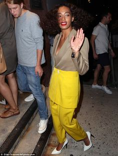 Fan favourite: Solange waved to her fans as she entered the party...