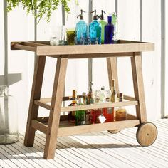 Garden party. Crafted from sustainably-harvested tropical hardwood, the Jardine Bar Cart stores and transports all the necessities for a successful summer soiree.