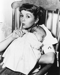 Debbie shows off her newborn daughter in 1956. Her first marriage, to singer Eddie Fisher, had ended when Carrie was just three: he left her for her friend, Elizabeth Taylor
