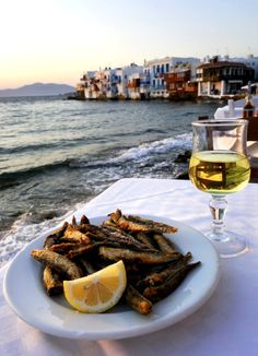 Greek Food and Wine in a sunset restaurant with Little Venice, Mykonos island, Greece. Mykonos Island, Santorini Greece, Greek Recipes, Wine Recipes, Does Your Mother Know, Sunset Restaurant, Myconos, Fried Fish, Greece Travel